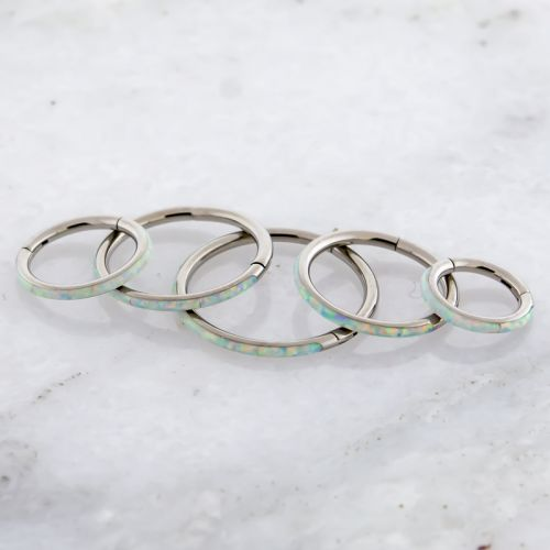 TITANIUM HINGED SEGMENT RING WITH SYNTHETIC OPAL INLAY